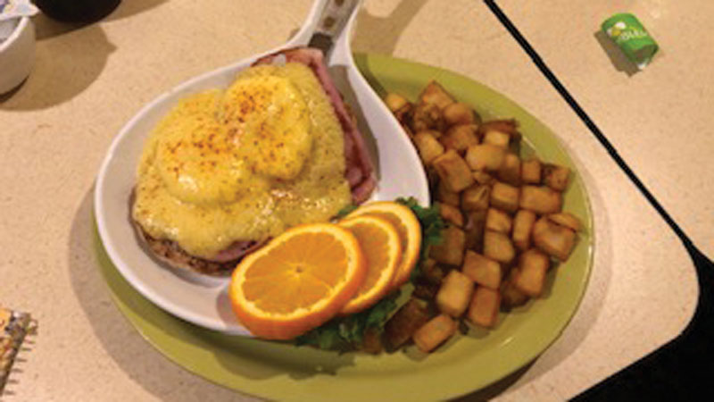 A classic blend of smoky sliced ham, soft poached eggs, English muffins, and a creamy Hollandaise sauce.