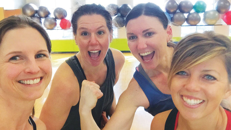 Sara (flexing, second from right) kept us motivated throughout class by cheering us on with her fun personality.