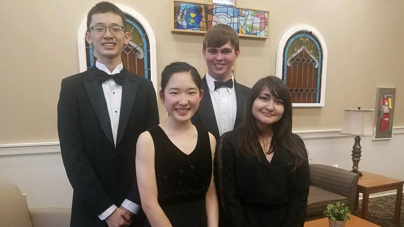 From left to right: Ethan Zheng, Emi Kawamura, Shane Reed, and Gabi Gazette.